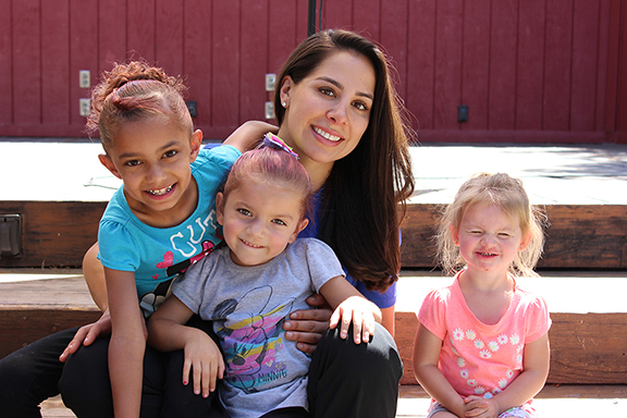 Nevaeh (left) with her younger sisters and Cynthia Sandoval of Lazarex Cancer Foundation.